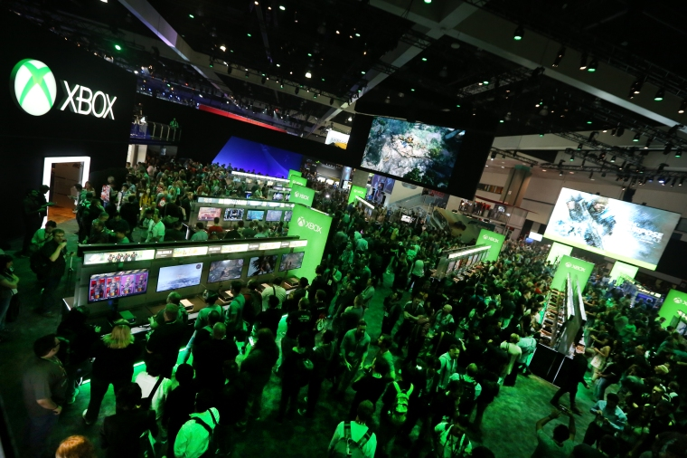 E3-2016-attendees-interact-with-newly-announced-games-and-experiences-Xbox-booth-at-E3-2016-in-Los-Angeles-June-14-2016.-Photo-by-Casey-Rodgers-Invision-for-Microsoft-AP-Images.jpg